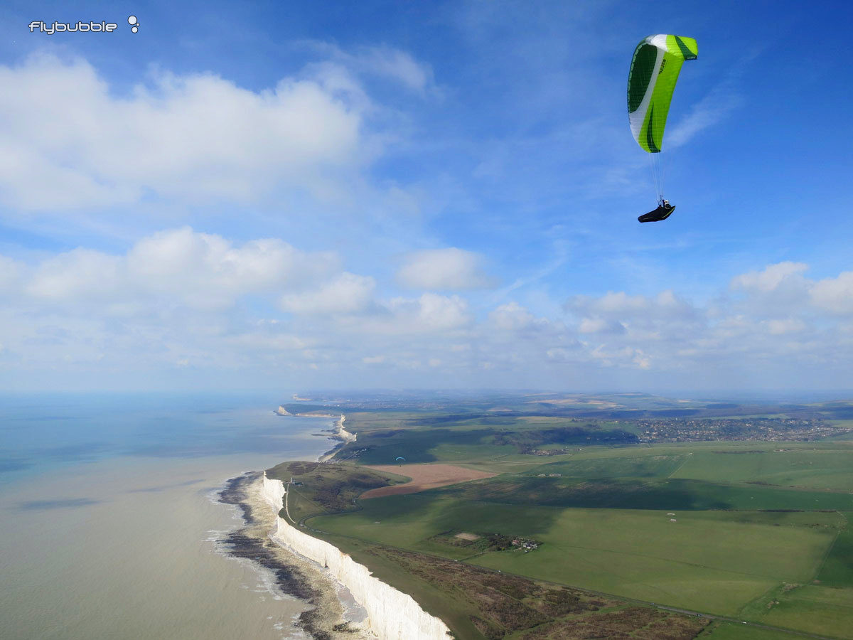 Flybubble Nancy making the most of sea thermals on a paraglider high above Beachy Head.