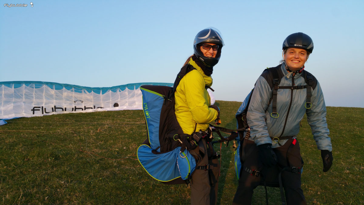 Nancy and Michelle, ready for another tandem flight, clipped in to our SUPAIR tandem pilot and passenger harnesses.