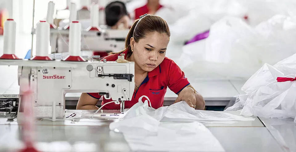 Skilled Advance factory worker assembling a wing
