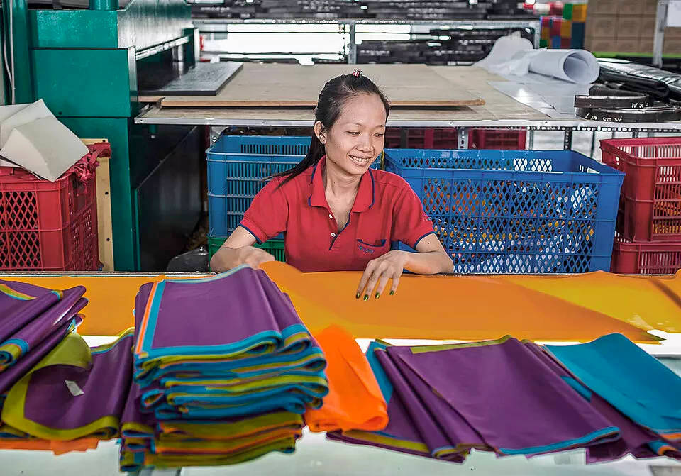 Advance factory worker checking materials